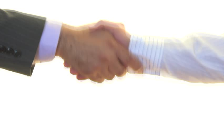 Two businessman shaking hands over white background, friendly handshake of two men