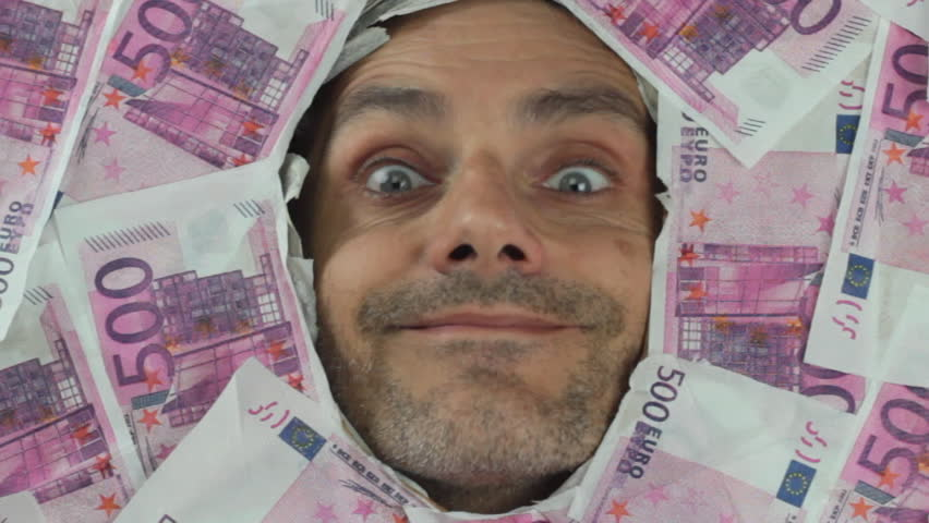 Funny man under a bed of euro notes - HD stock footage clip