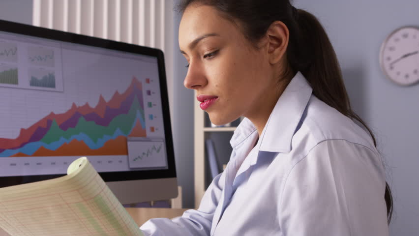 Mexican businesswoman working hard by computer - HD stock footage clip