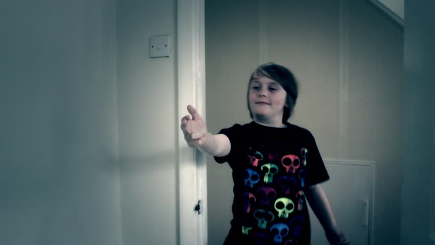 A young boy using his fingers as a gun and getting shot - HD stock video clip