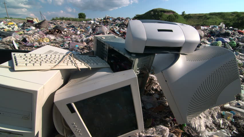 Old desktop computer parts at the garbage dump tracking shot