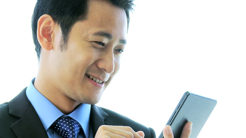 Head shoulders ambitious Asian Chinese male advertising executive seeing news success via wireless mini tablet close up | Shutterstock HD Video #6644183