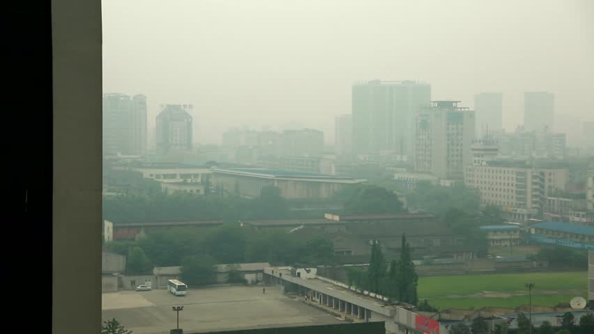 People, traffic, and pollution in Chengdu China | Shutterstock HD Video #6671003