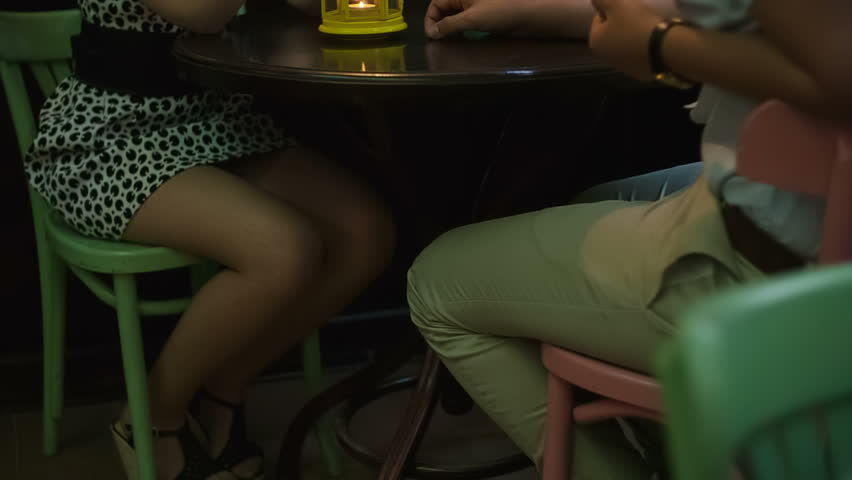 Couple sitting at sidewalk cafe. RAW video record. - HD stock video clip