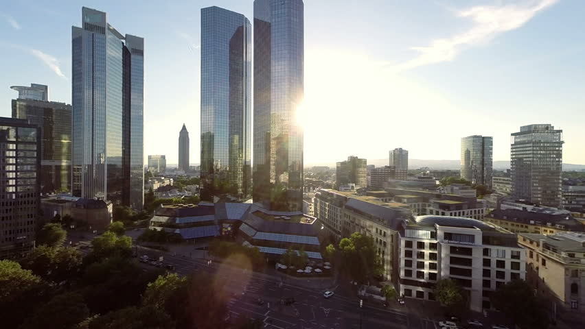 skyline frankfurt am main. bank banking. business background. financial district. aerial view. helicopter fly over. real estate. city cityscape. sunset magic hour. landmarks  - HD stock footage clip