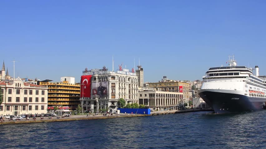 ISTANBUL - OCT 6, 2011: Cruise Ship Terminals from the water side. The docks for cruise ships extend along the shore from Karakoy Port to the Tophane Region. Pan from Kabatas to Karaky.
