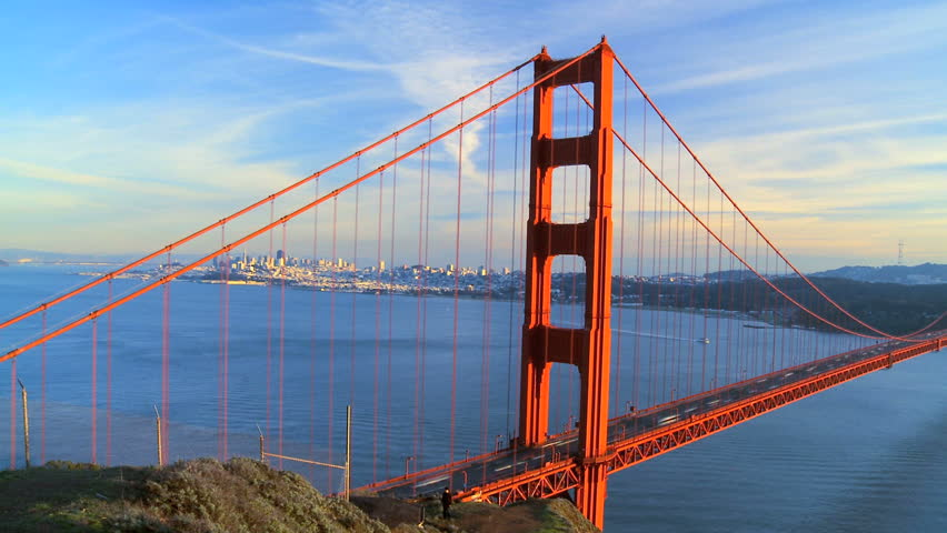 Time-lapse shot of traffic on Golden Gate Bridge, San Francisco with city skyline in background - HD stock footage clip