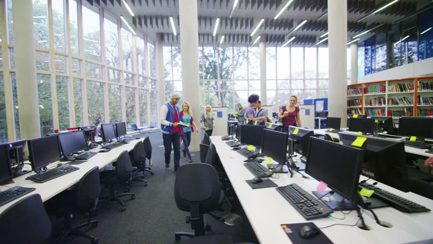 Diverse group of students working together in study area of modern university