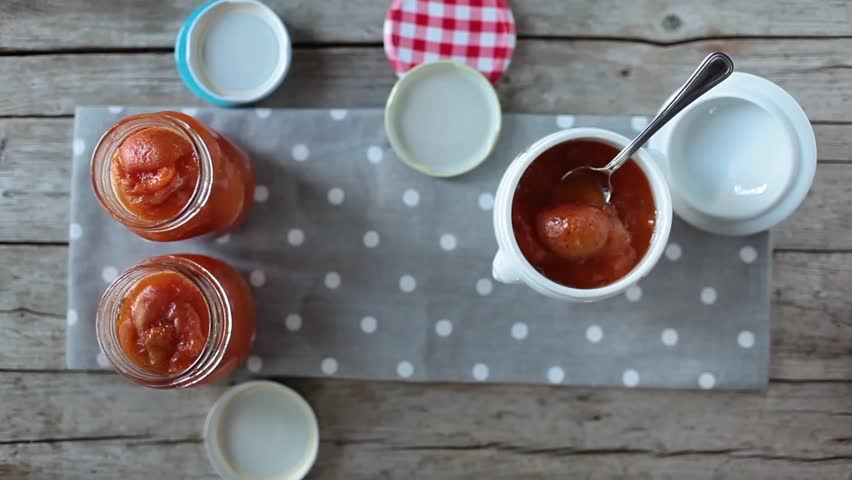 Apricots Marmalade Jars - Video clip of jars with fresh homemade apricots marmalade.