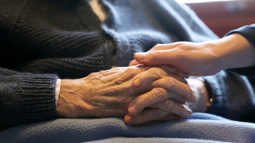 A young hand comforting a old pair of hands. - HD stock video clip