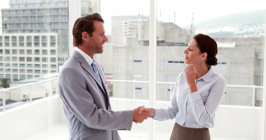 Chatting business team shaking hands in the office - 4K stock footage clip