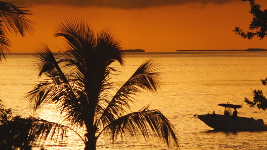 Saltwater fishing in Florida Keys, Fishing boat at sunset. - HD stock video clip
