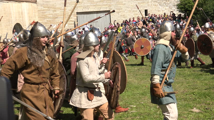 SAINT-PETERSBURG, RUSSIA - JUNE 30, 2014: A battle. The fight of the Vikings. Medieval warriors. Historical reconstruction. Shot in 4K.