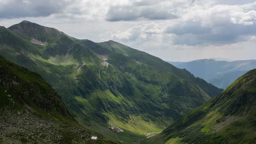 Fagaras Mountains shadows across landscape 4K