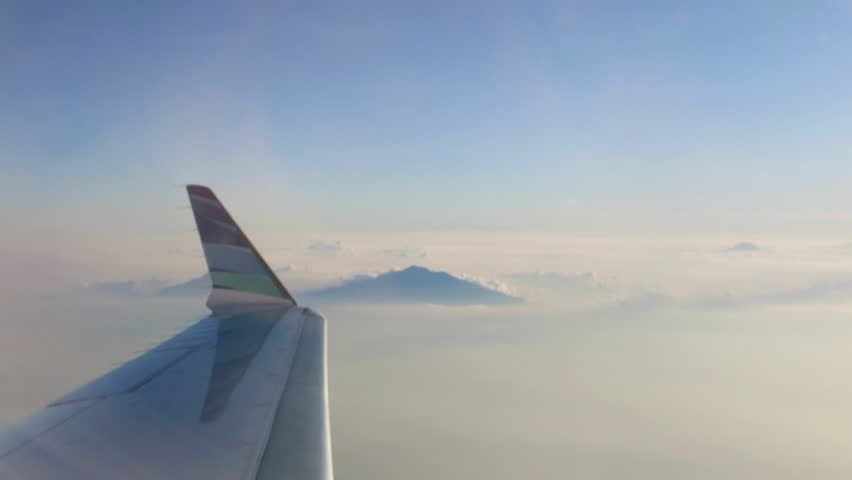 plane clouds and mountains - photo #20