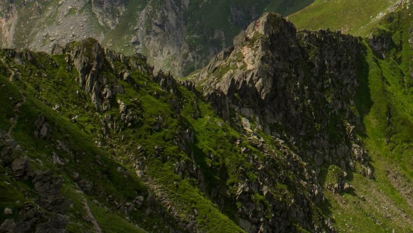 Carpathian mountain ridge, hikers on difficult path
