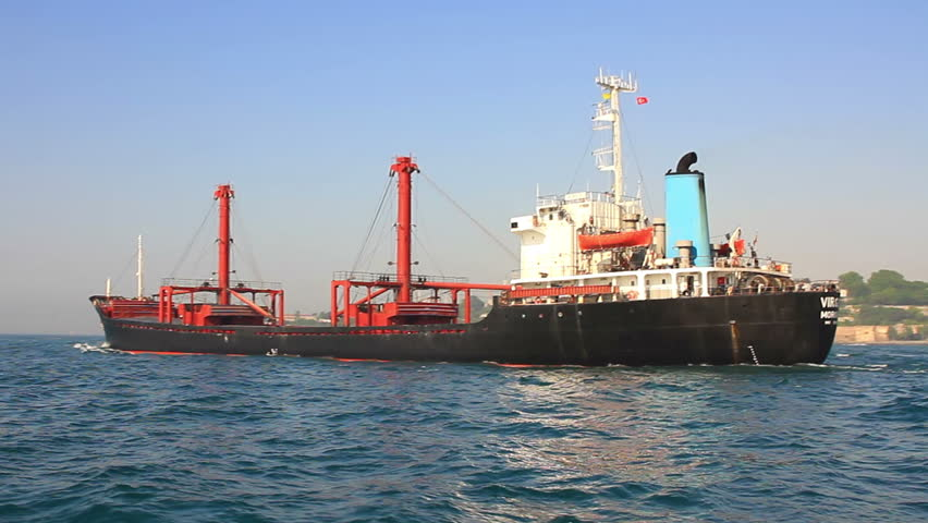 ISTANBUL - MAY 26, 2014: Bulker ship VIRGO (IMO: 7371367, Comoros) 129 mt long vessel has a deadweight of 11994 tons. Bulker cruising into sea. Tracking shot of bulk carrier ship cruising into the sea