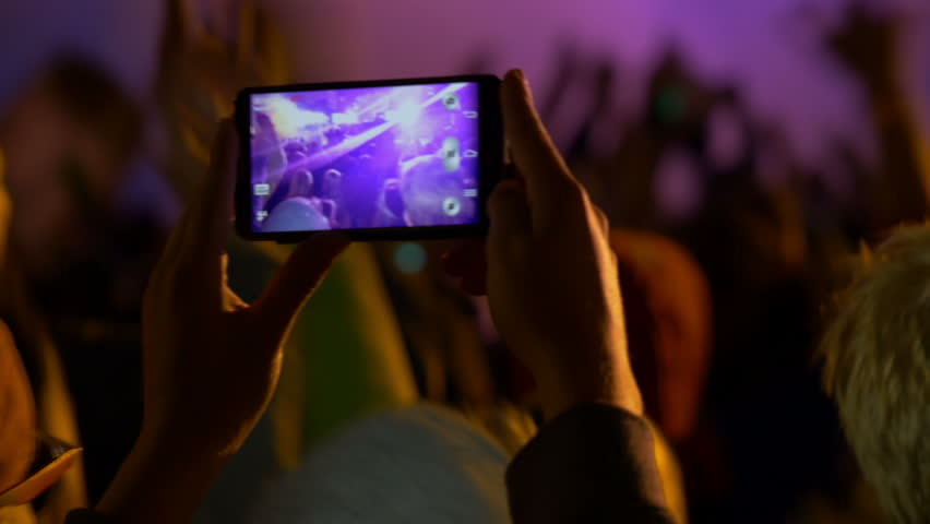 4K making video with cell phone at live music concert, festival