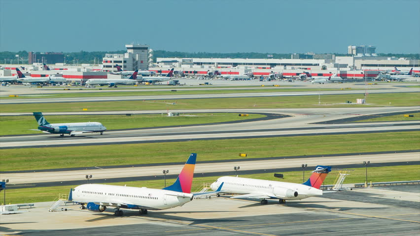 ATLANTA - 2014: Airfield Timelapse at Hartsfield-Jackson Atlanta International Airport on a Sunny Day with Aircraft Landing, Taking Off and Taxiing.