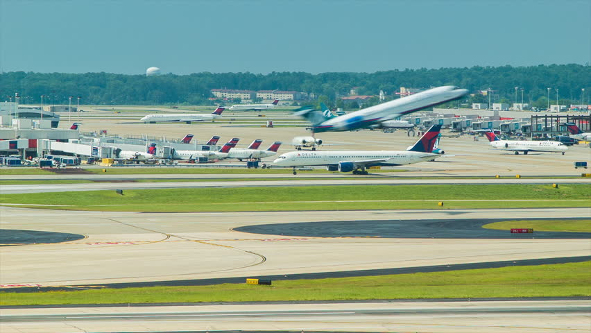 ATLANTA - 2014: Vibrant and Busy Atlanta International Airport with Commercial Passenger Airplanes from Various Airlines at Terminals, Taxiing, Landing, and Taking off at the World's Busiest Airport.