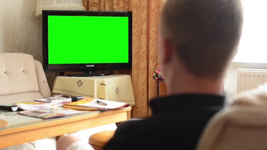 Man watches TV(television) - green screen - living room  - HD stock video clip