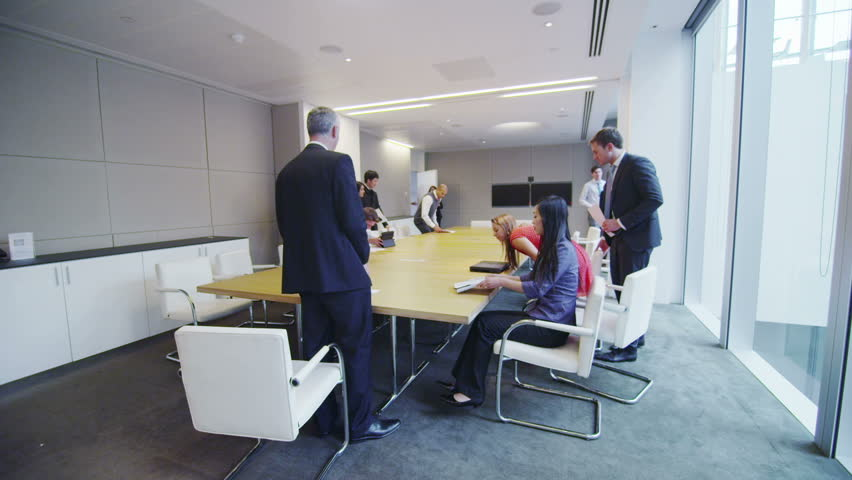 Diverse business team in boardroom meeting in a large modern office building