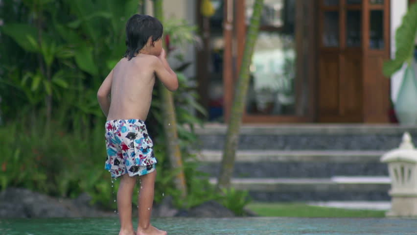 Boy nosediving in the swimming pool, slow motion shot at 240fps  - HD stock video clip