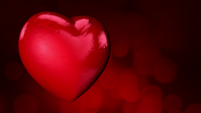 Bokeh Heart Shape Of Light Background Stock Footage Video: Candy Red Heart Beats. Loop Animation. Bokeh Light