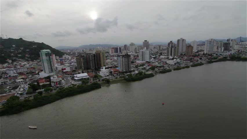 Aerial view of the city of Itajai, Brazil - restaurants, food fruit of the sea, river itajai acu, fishing industry