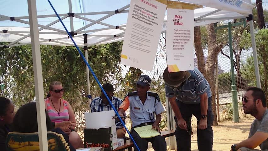 KASANE, BOTSWANA - CIRCA SEPTEMBER 2014 - UNICEF volunteers setup Ebola virus screenings at border crossing between Zimbabwe and Botswana on Sept 12, 2014 in Africa. All visitors are questioned.