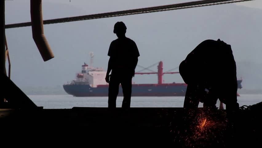 Paranagua, PR - Brazil  - View of the port of paranagua, ships unloading soybean, transportation of wealth Parana. silhouetted people intro