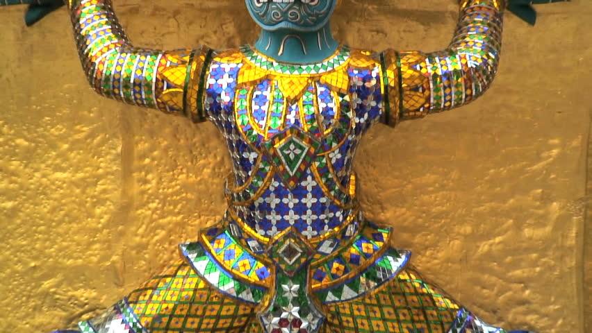 Yaksha supporting golden chedi at Wat Phra Kaeo temple Bangkok Thailand