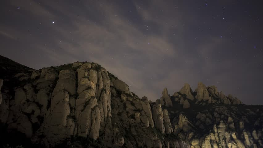 Montserrat rocks with stars and clouds. timelapse footage.