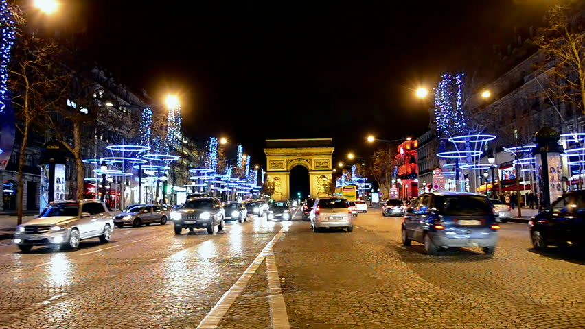 paris france november 2014 the champs elysees by a cold winter night cars are passing by. Black Bedroom Furniture Sets. Home Design Ideas