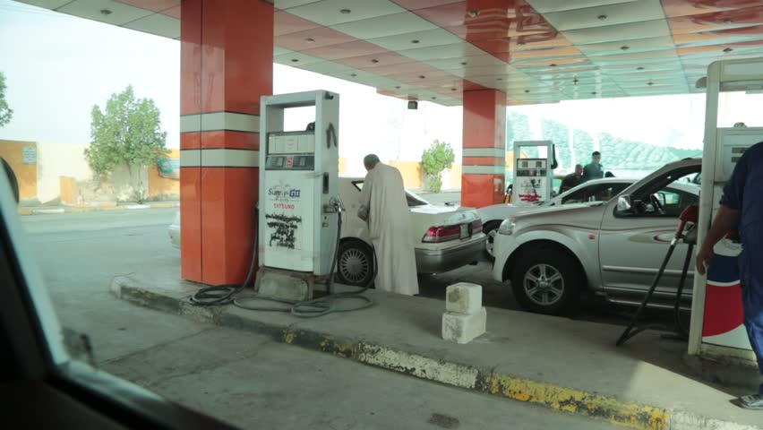 Baghdad, Iraq, October 2014:  A Typical Scene of an Iraqi Petrol (Gas) Station Worker Waiting for the Next Customer at a Petrol (Gas) Station in Baghdad, Iraq, October 2014.