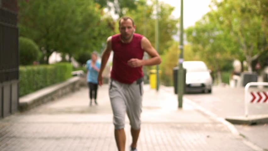 Man resting after running, slow motion shot, steadycam shot  - HD stock video clip