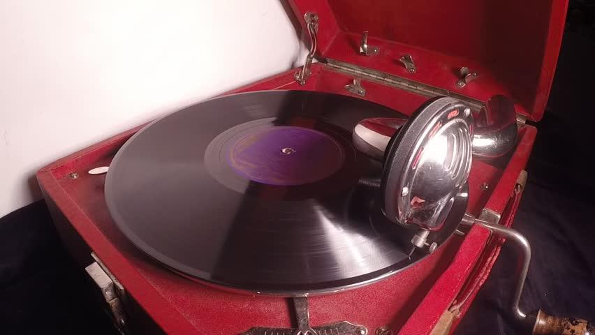 old gramophone closeup playing vinyl record
