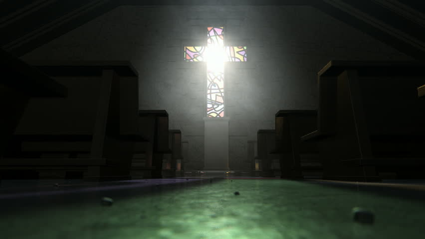 A a pan across the aisle of an old church lit by suns rays penetrating through a stained glass window in the shape of a crucifix reflecting colors on the floor in amongst rows of church pews - HD stock footage clip