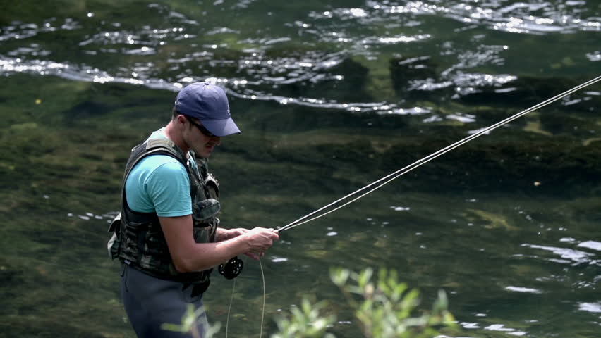 Fisherman casting during fly fishing near the rapid of for Fly fishing supplies near me