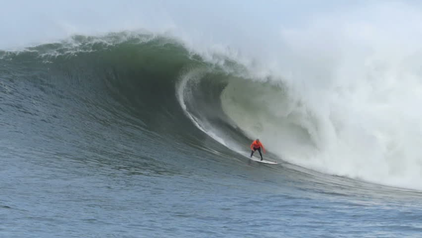 Half Moon Bay, California, USA – Jan. 24, 2014: Professional Surfer, Shane Dorian surfing on a giant wave during the Mavericks Invitational surf competition.
