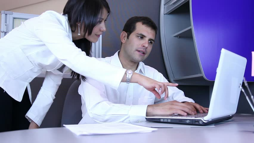 Business couple working on a laptop at the office - HD stock video clip