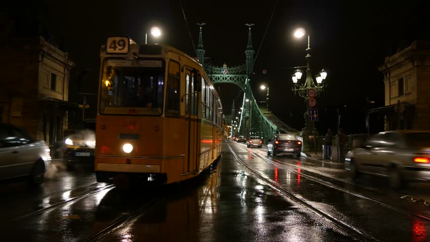 BUDAPEST - DECEMBER 02: Tram traffic in Budapest closeup at the Liberty Bridge in Budapest by night December 02, 2014 in Budapest, Hungary.