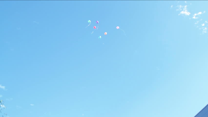 Balloons fly up in the air. Holiday, children's holiday, feast, fete , gala day