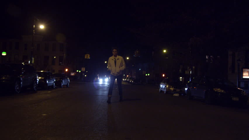 Man walking down the street at night not agree