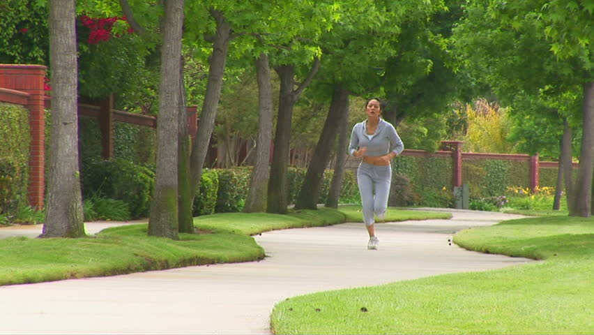 Young woman jogging - HD stock footage clip
