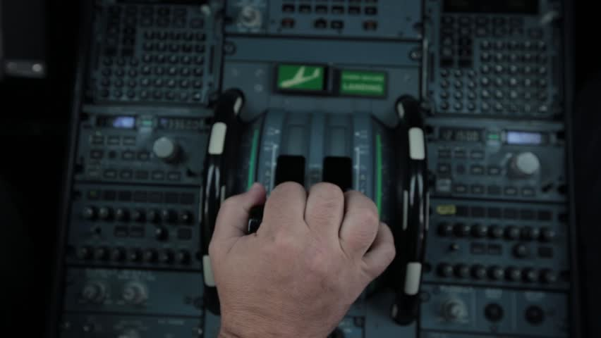 Cockpit cabin inside. Hand of pilot push handle for takeoff