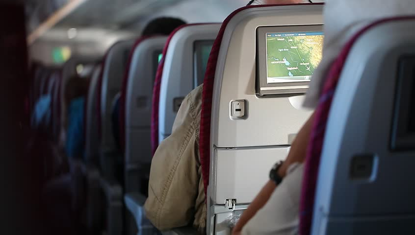 Russia,Moscow - March 15, 2014: Passengers in the interior of the aircraft Qatar Airways.