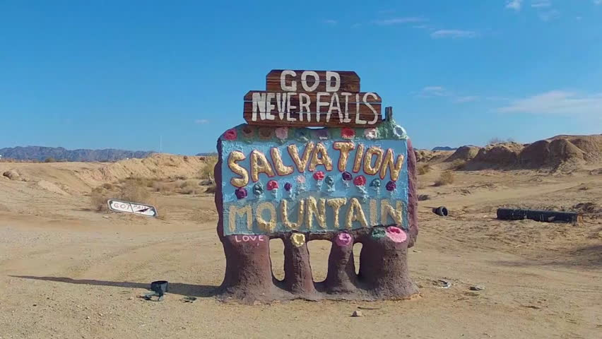 NILAND, CA: December 6, 2014- Sign for Salvation Mountain circa 2014 in Niland California. A colorful sign announces the location of a religious based tourist attraction in Southern California.