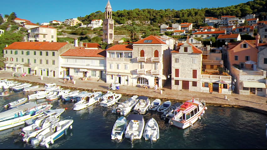 Hvar Island, Croatia was named as Lonely Planet's number 5 destination for 2012 and Conde Nast voted it among the top ten islands in Europe. This aerial drone overhead footage is of the main harbor. - HD stock video clip