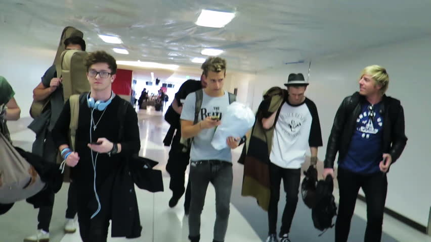 LOS ANGELES, CA/USA - NOVEMBER 24, 2014: The Vamps at Los Angeles International Airport. 1080p HD.